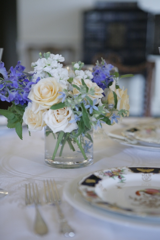 Ivory garden roses with white stock, tweedia, and delphinium