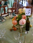 Festive arrangement of peach dahlias and mint