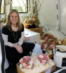 Julie with flowers and other sundries in the Petalena van